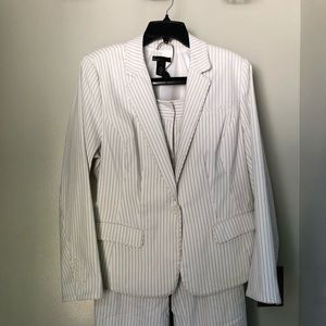 White pant suit w/ black pinstripes